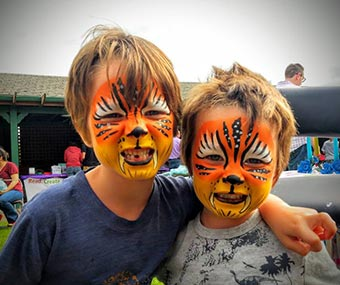 Magical Wand Face Painting - boys with tiger face painting