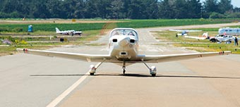 small plane landing on Half Moon Bay runway