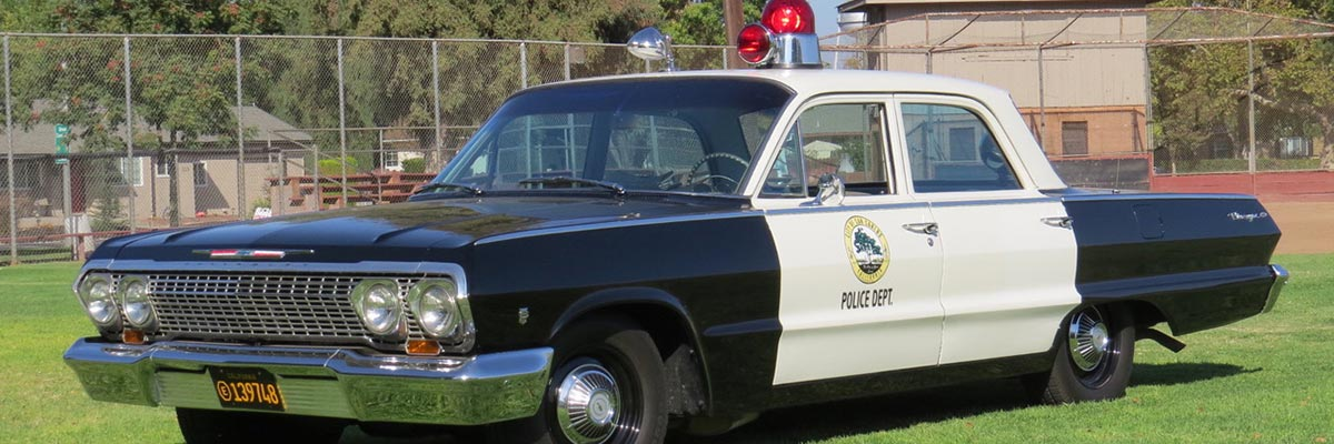 vintage police cars at Pacific Coast Dream Machines show